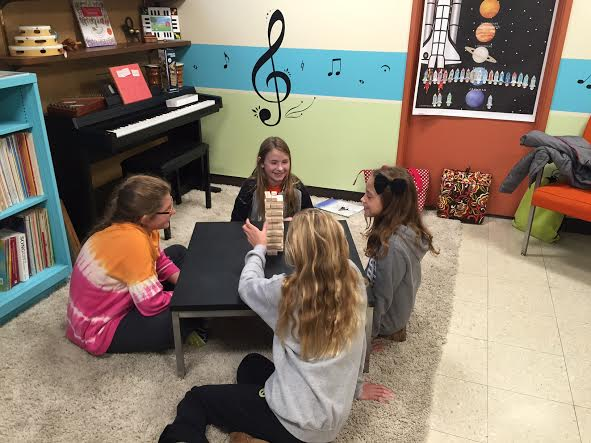 Ava, Abbey, Mia, and Gianna test their skills at Music Jenga